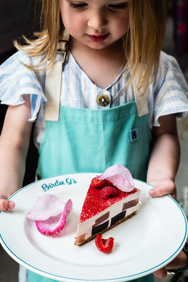 Birdie holding a slice of World Famous Rose Petal Pie